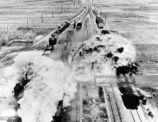 circa 1950 A train is attacked in North Korea by American B26 light bombers using napalm bombs which causes a huge fireball to erupt and cause...