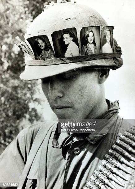 War and Conflict The Vietnam War Cu Chi South Vietnam pic May 1968 An American soldier keeps a constant reminder of his girlfriend back home with his...