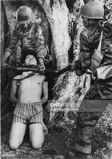War and Conflict, The Vietnam War, near Baq Quah, South Vietnam, pic: March 1965, A captured Viet Cong suspects guerilla receives some rough...