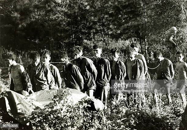 War and Conflict The Vietnam War near Da Nang South Vietnam pic February 1969 A group of captured Viet Cong guerilla suspects are marched away with...