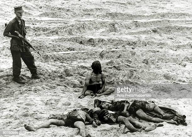 War and Conflict The Vietnam War near Da Nang South Vietnam pic September1965 A captured Viet Cong prisoner sits hooded and guarded by an American...