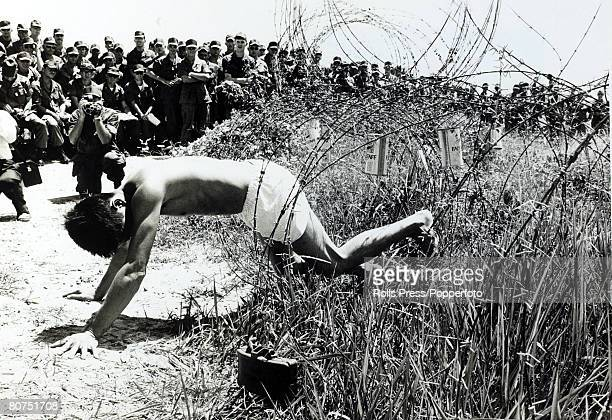 War and Conflict The Vietnam War near Long Binh South Vietnam pic August 1969 American soldiers watch as former Viet Cong sapper demonstrates how a...