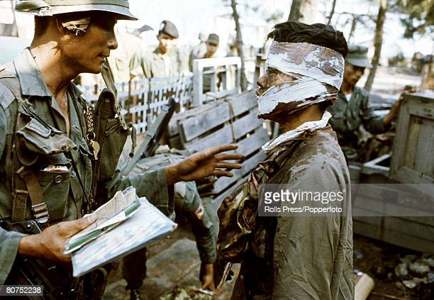 1968 Hue South Vietnam A wounded bloodsoaked Viet Cong is questioned by a South Vietnamese soldier during the bitter fighting for the city of Hue