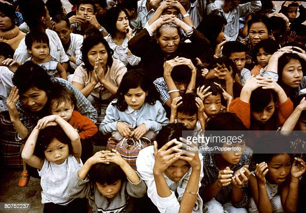 1968 Hue South Vietnam Women and children sit with hands on their heads during the bitter fighting for the city of Hue