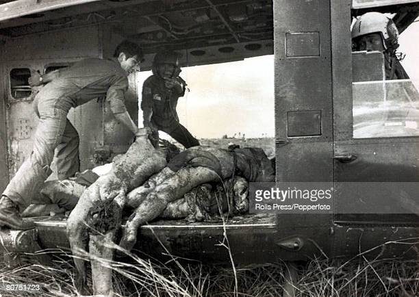4th April 1975 near Son Nhut South Vietnam A helicopter crew load bodies on to the chopper these were some of the victims of a crashed American C5...
