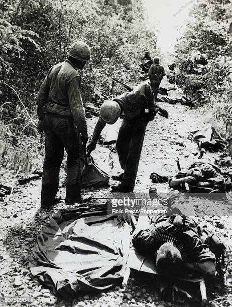December 1965 Michelin Plantation South Vietnam Dead and wounded Americans on a jungle track after a Viet Cong ambush as US 1st Army Infantry...