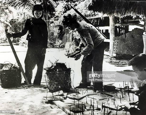 December 1965 Quang Ngai Province South Vietnam Communist guerillas prepare spikes on wooden platforms to be used to maim South Vietnamese and...
