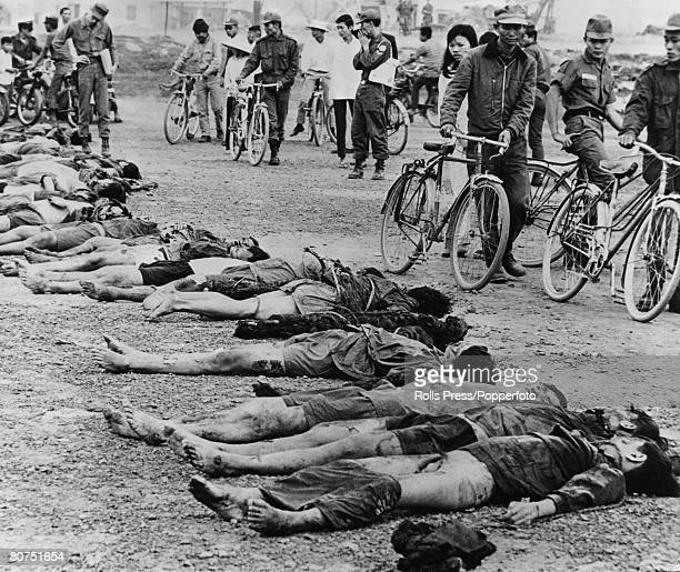 February 1968 Da Nang South Vietnam The bodies of some 30 Viet Cong are laid out for local people to see after an attack on Da Nang which destroyed...