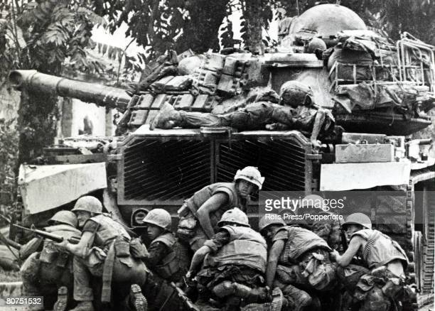 February 1968 Hue South Vietnam US marines take cover behind a tank as they cower from communist sniper fire