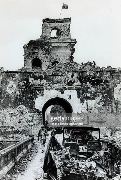 February 1968 Hue South Vietnam Burnt out American vehicles and eguipment amongst the destruction in the city at the southwest gate after American...