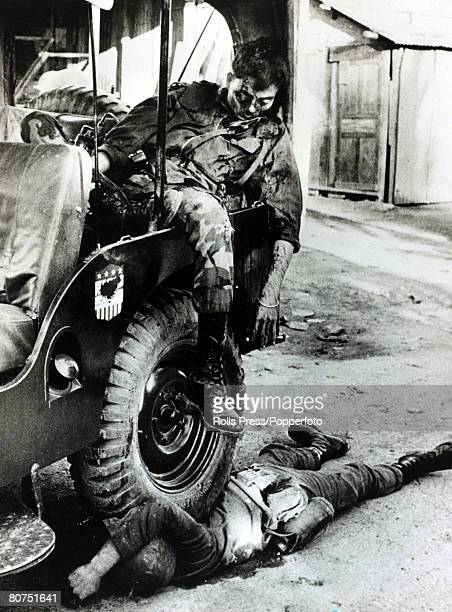 January 1968 Saigon South Vietnam A South Vietnamese major lies dead slumped in a jeep after being shot in the face by Viet Cong guerillas his driver...