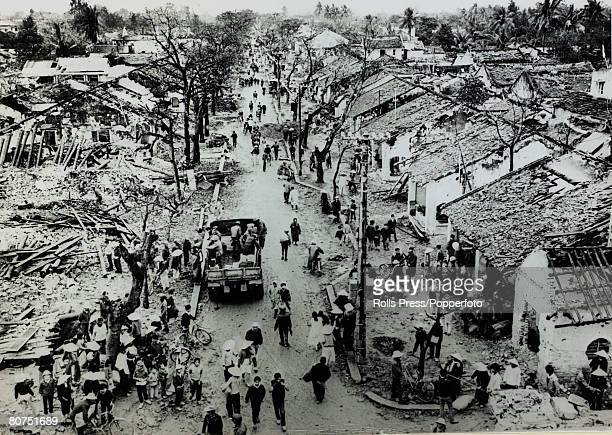 March 1968 Hue South Vietnam Local residents sift through the rubble of their homes after the battleafter American marines had finally secured the...