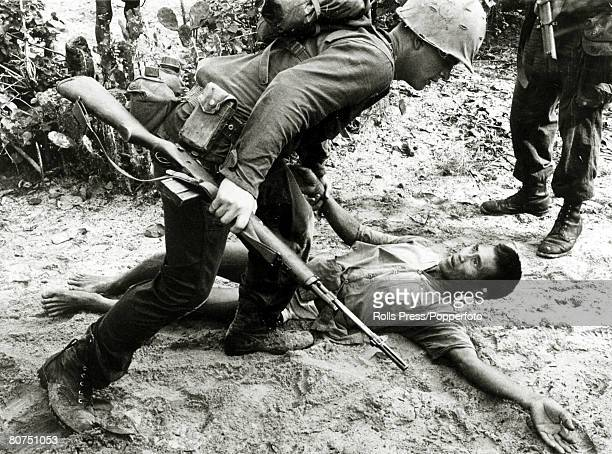 May 1966 Tinh Tuy South Vietnam A US marine grapples with a Viet Cong soldier who had been captured
