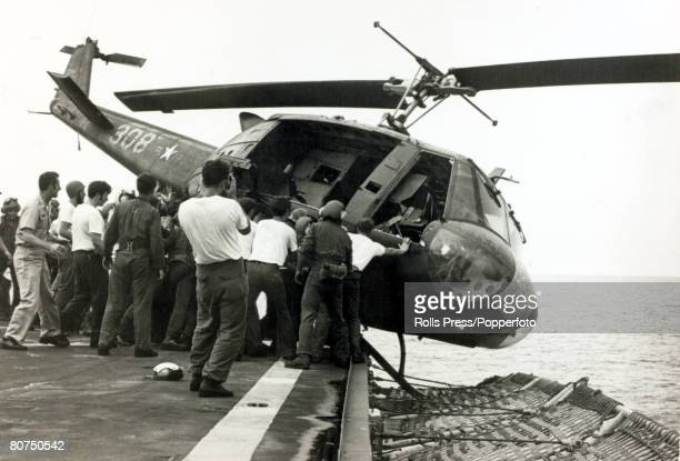 May 1975 South Vietnam A South Vietnamese helicopter is pushed over the side of an American ship to make way for other helicopters to have room to...
