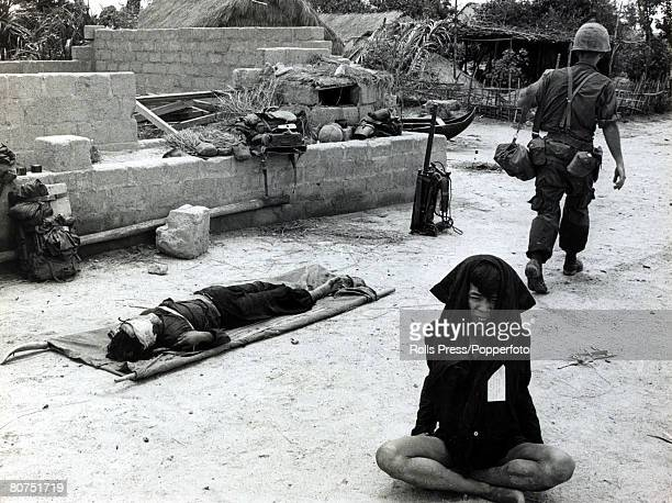 War and Conflict The Vietnam War Qui Nhon South Vietnam pic September 1965 A captured Viet Cong suspect anxiously sits cross legged on the floor...
