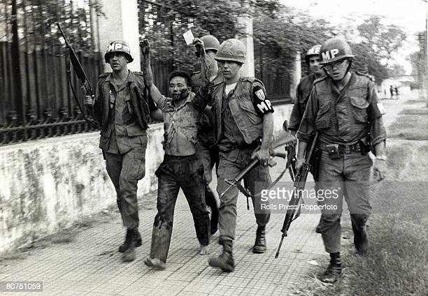 War and Conflict The Vietnam War Saigon South Vietnam pic February 1968 American military policemen take away a Viet Cong terrorist one of a group...