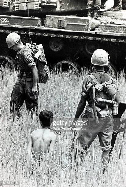 War and Conflict The Vietnam War South Vietnam pic circa 1968 A captured Viet Cong guarded by American soldiers