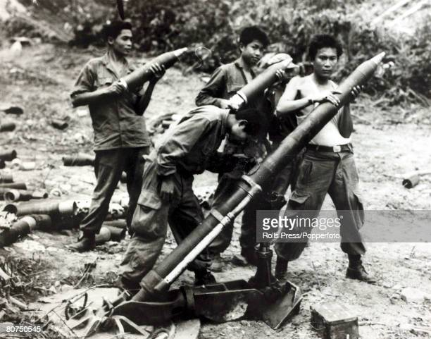 War and Conflict, The Vietnam War/Laos, pic: April 1961, Vang Vieng, Laos, Royal Laotian soldiers prepare a mortar gun for firing to try to stop the...