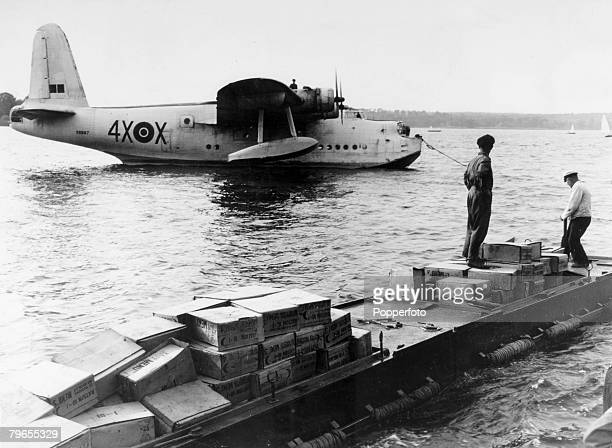 July 1948 Berlin A British Sunderland flying boat having landed on the Wannsee being unloaded of vital foodstuffs for beseiged Berlin The airlift was...
