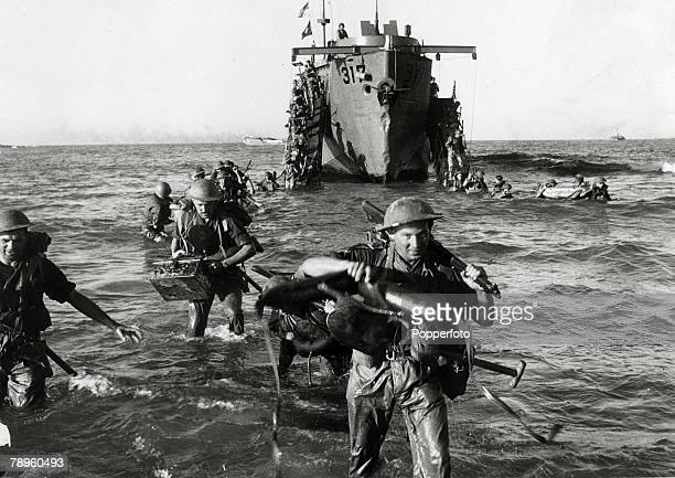 1943 Allied invasion of Sicily with troops wading ashore from a landing craft