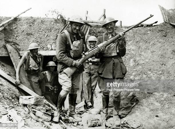 War and Conflict World War I 19141918 France British officers examine a German antitank gun after taking an enemy trench in the advance on Bapaume
