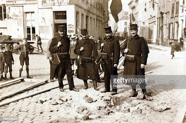 War and Conflict World War I 19141918 The German occupation of Belgium pic 1914 Belgian soldiers in the street near shell damage this caused by the...