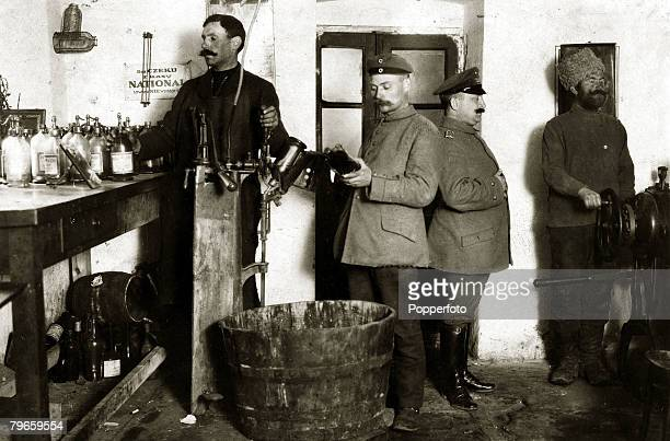 War and Conflict World War I 19141918 The German occupation of Poland A German regimental chemist with his assistants making poison gas in a...