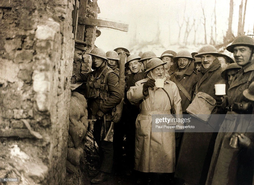 War and Conflict World War I. (1914-1918). Ben Tillett M.P., (light coat) a leading socialist, politician and trade unionist pictured with British troops in France. : News Photo