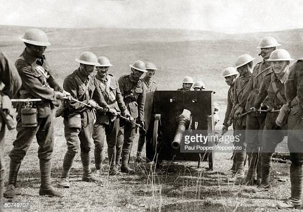 War and Conflict World War I British troops hauling a gun into position under cover of a ridge at Salonika