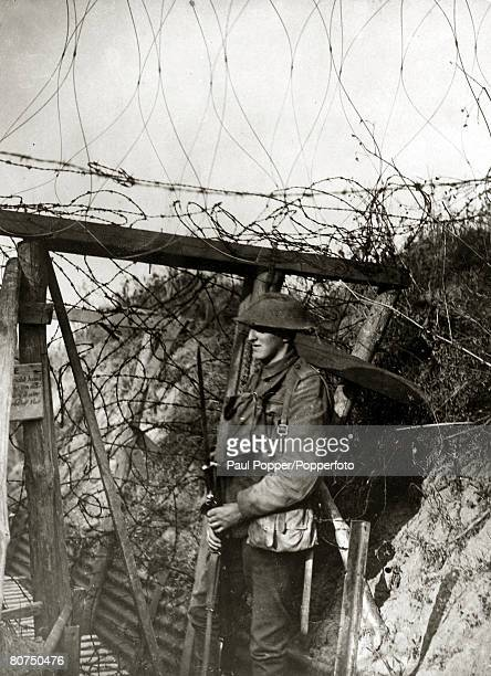 War and Conflict World War I France A British soldier on duty at a barbed wire gate The wire gate can be closed if the Germans attack slowing their...