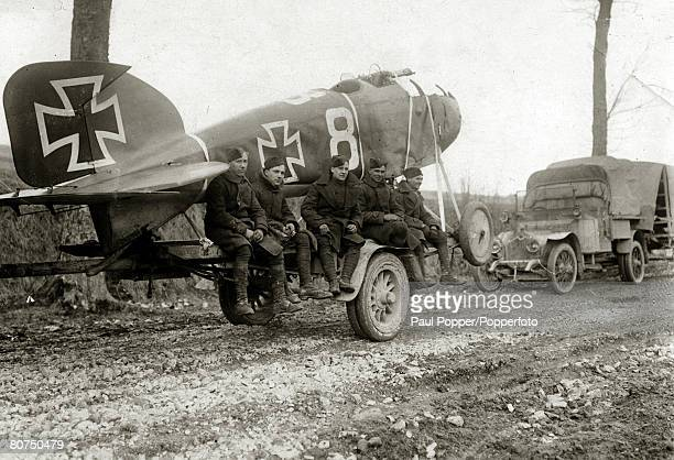 War and Conflict World War I France Men of the Royal Air Force pose with a captured German Albatross aeroplane minus it's wings