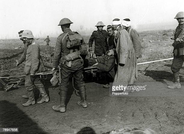 12th September 1916 France A wounded British Guards officer being carried on a stretcher by captured German prisoners
