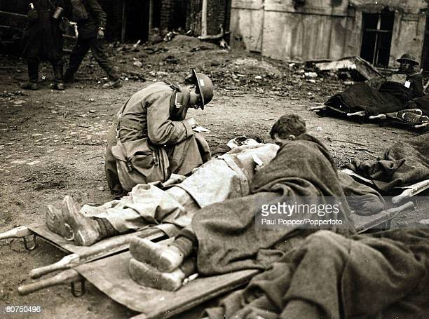 War and Conflict World War I pic 1917 A Chaplain writing letters home for wounded British troops during the British victory at Cambrai France