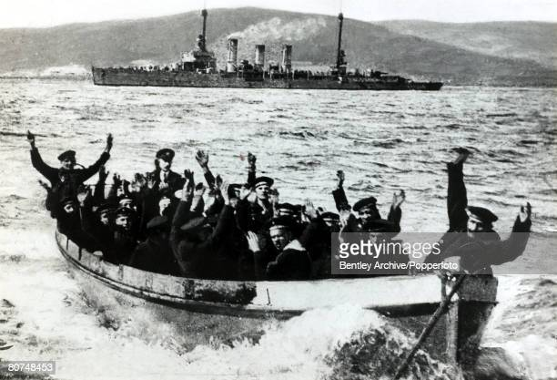 War and Conflict, World War I, pic: 21st June 1919, The German Fleet scuttled at Scapa Flow, German sailors in a boat approaching the shore after...
