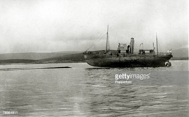 23rd June 1919 The German Fleet scuttled at Scapa Flow The whaler 'Ramna' stranded as it sits on the half submerged German battlecruiser 'Moltke'...
