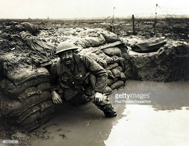 War and Conflict World War I Western Front pic January 1917 A British soldier in a flooded dugout in a front line trench near Ploegsteert Wood...