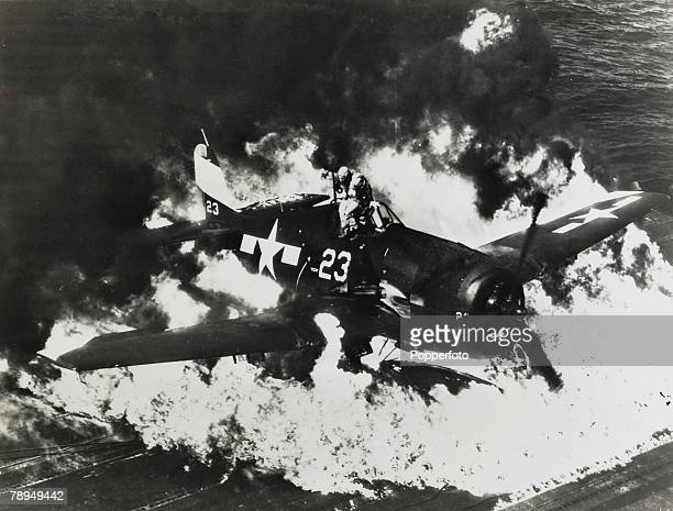 War and Conflict World War II Far East pic 25th February 1945 The American pilot of this Hellcat fighter plane leaps for safety as the external fuel...