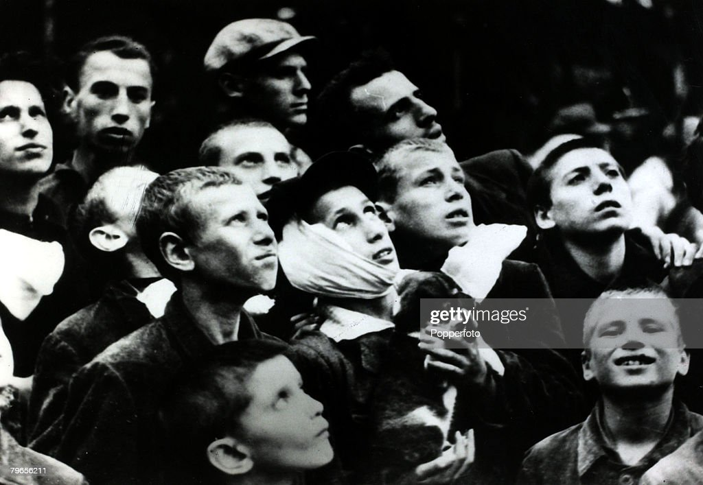 War and Conflict, World War II, Germany invades Poland, pic: 14th September 1939, A group of anxious Polish youngsters watch a German air raid on the city of Warsaw