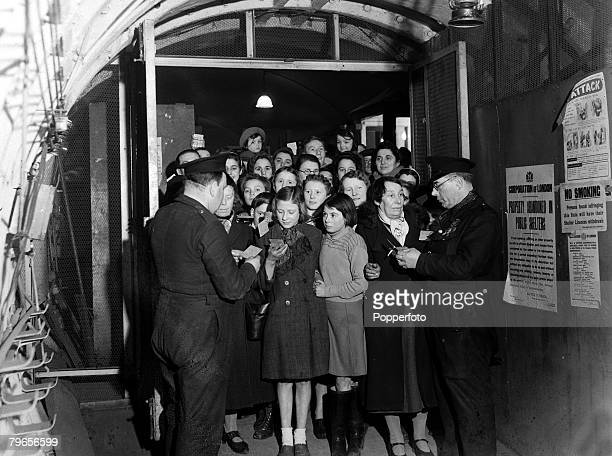 War and Conflict World War II People pic April 1941 Londoners are checked into Liverpool Street Underground Station by wardens who help to organize...