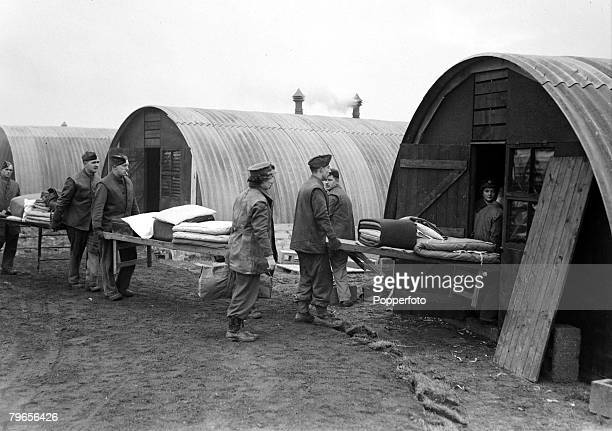 War and Conflict, World War II, pic: 17th November 1944, ATS, girls assisted by troops move into their nissen hut accomodation