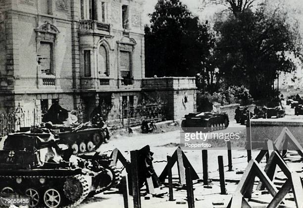 1940 A German armoured column entering the French town of Sedan evacuated bt the French Army with the tanks bypassing the antitank barriers Germany's...
