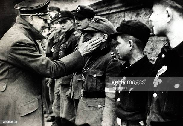 War and Conflict, World War II, pic: 20th April 1945, German leader Adolf Hitler decorates Hitler Youth on his 56th birthday for their brave fighting...