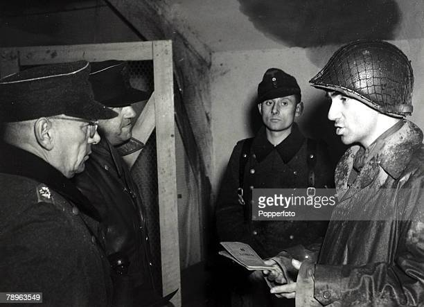 23rd November 1944 A US officer cross examines German Colonel Constantine Meyer the military commander of Metz France and Major General Anton...