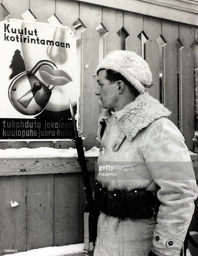 4th February 1940, A Finnish soldier reads a poster issued