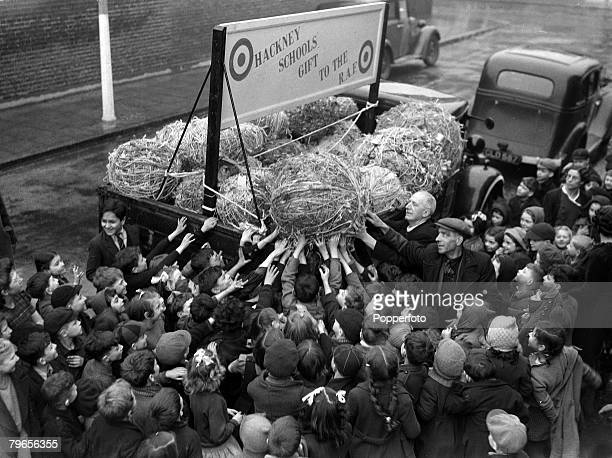 6th February 1943 Schoolchildren in Hackney East London help load a lorry with bales of string to be used by the RAF