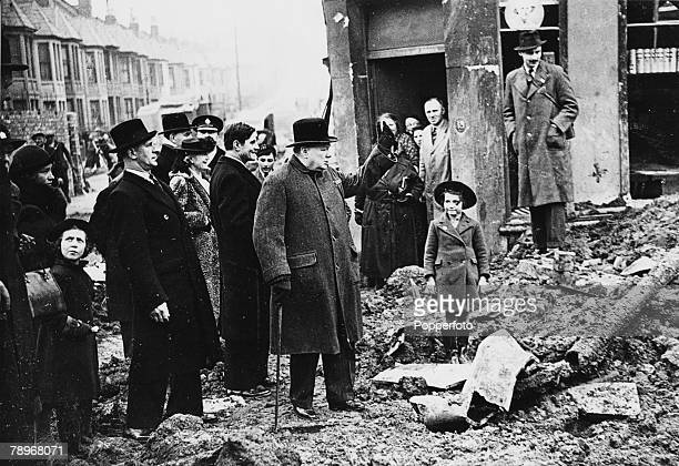 circa 1940 British Prime Minister Winston Churchill visiting bomb damaged areas