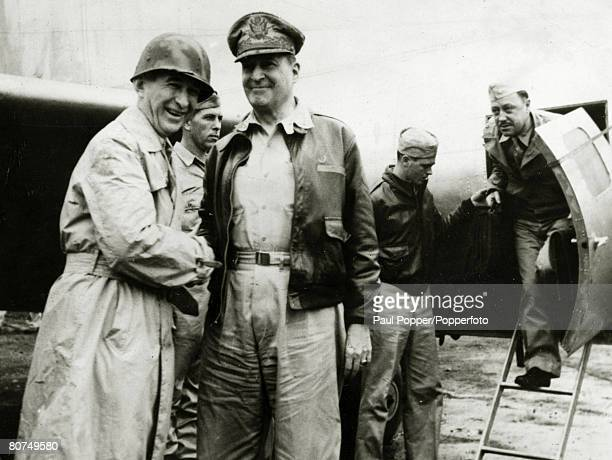 circa 1944 General Douglas MacArthur on a tour of the south west Pacific is greeted by Lieutenant General W Kreugar left