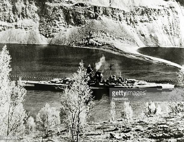 circa 1944 The 35000 ton German battleship 'Tirpitz' pictured in a Norwegian fjord the threat to Allied shipping was finally sunk late in 1944