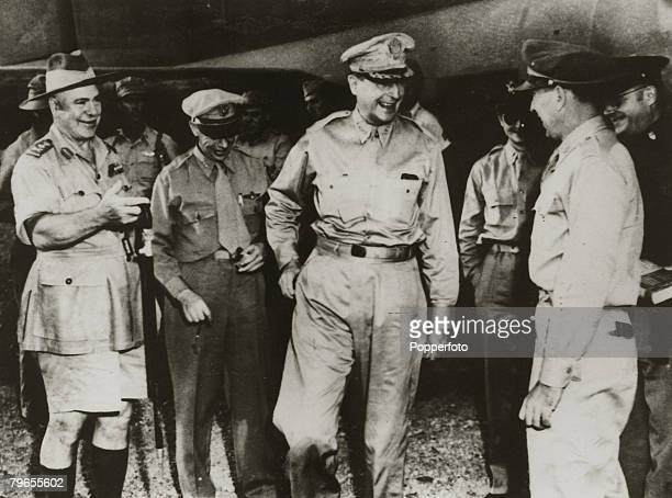 January 1943 General Douglas MacArthur 2nd right in good spirits as he arrives in New Guinea to be greeted by senior officers