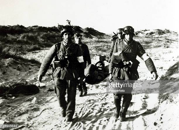June 1940 The Battle of Dunkirk German medical corps carry away a wounded fellow countryman The Battle of Dunkirk which took place approx 25th May...